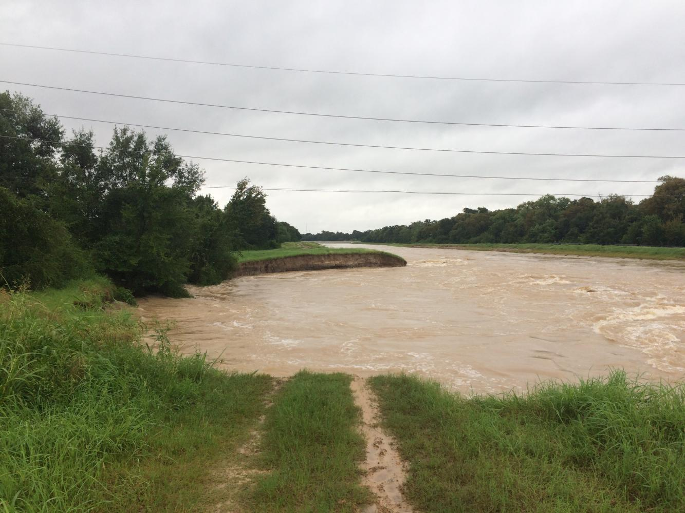 Buffalo Bayou continues to flow rapidly after Harvey seizes a large chunk of the bank. The hurricane damaged a vast amount of land in the Houston area.