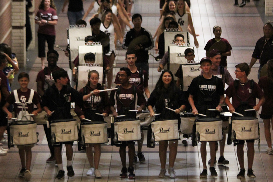 Drumline members march toward the rotunda. Cheerleaders as well as members partake in Spirit Circles, which now take place during 2.5