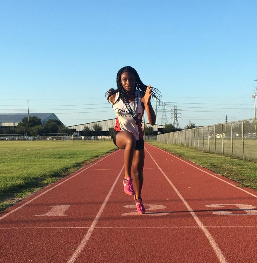 Irene Arinze breaking into a full sprint at the Garland McMeans Junior High School track.