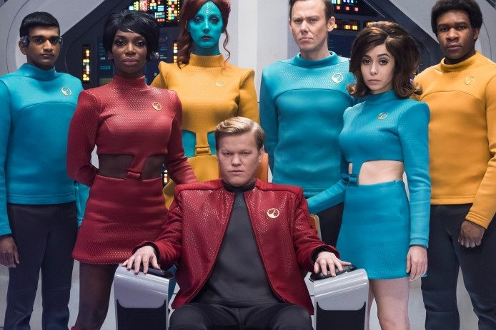 The Crew of the USS Callister, led by the notorious Captain Robert Daly, stands aboard their ship's bridge in the first episode of Black Mirror's fourth season.
