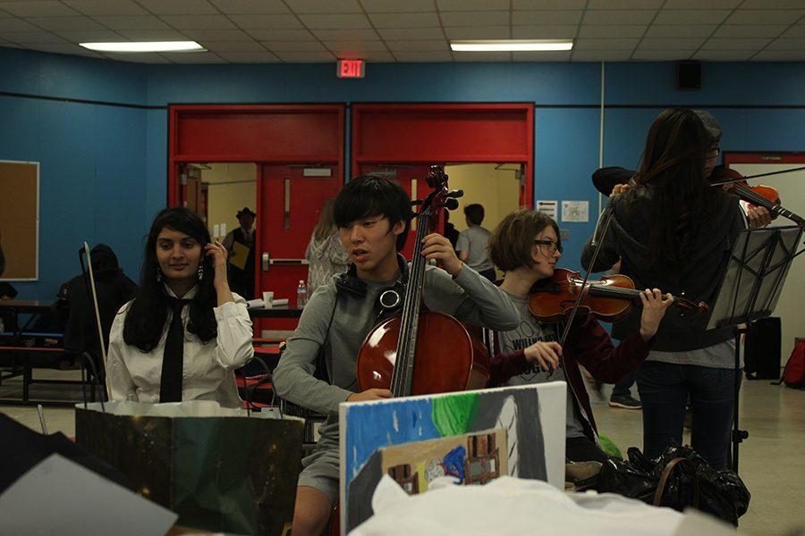 Sophomore Ankita Ghosh, senior Fenton Luong, and sophomore Isabella Conti practice for Contemporary Music.