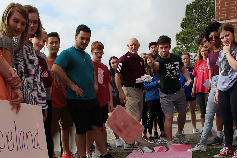 Students compete in the Ham Toss event, trying to hit targets with various pieces of deli meat.
