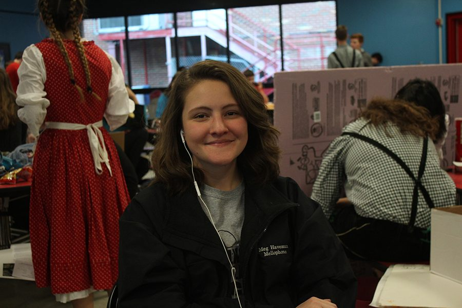 Senior Meg Haveman waits in the cafeteria for Polka Band.