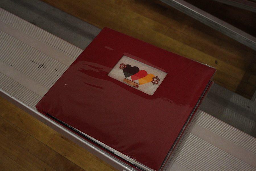 A scrapbook created by seniors Angelica Arinze , Karolis Vaiciulis, and Megan Ward.