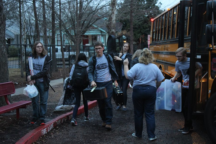 German Club students unload the bus at Hoggs Junior High on the day of competition.