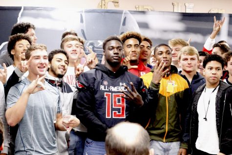 Gbenda is surrounded by teammates at his UnderArmour All-America Team jersey presentation ceremony Thursday.