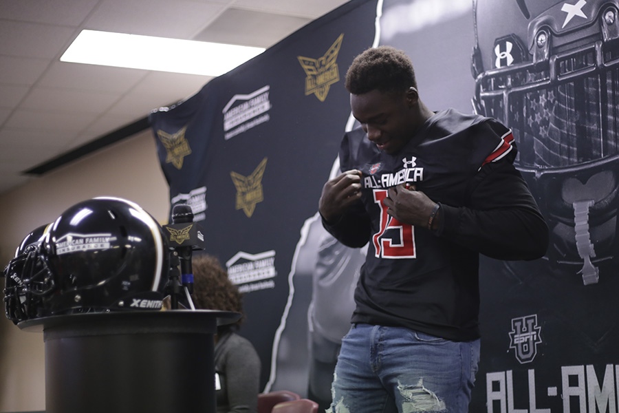 Gbenda+tries+on+his+new+UnderArmour+All-America+Team+jersey+and+takes+in+the+moment.