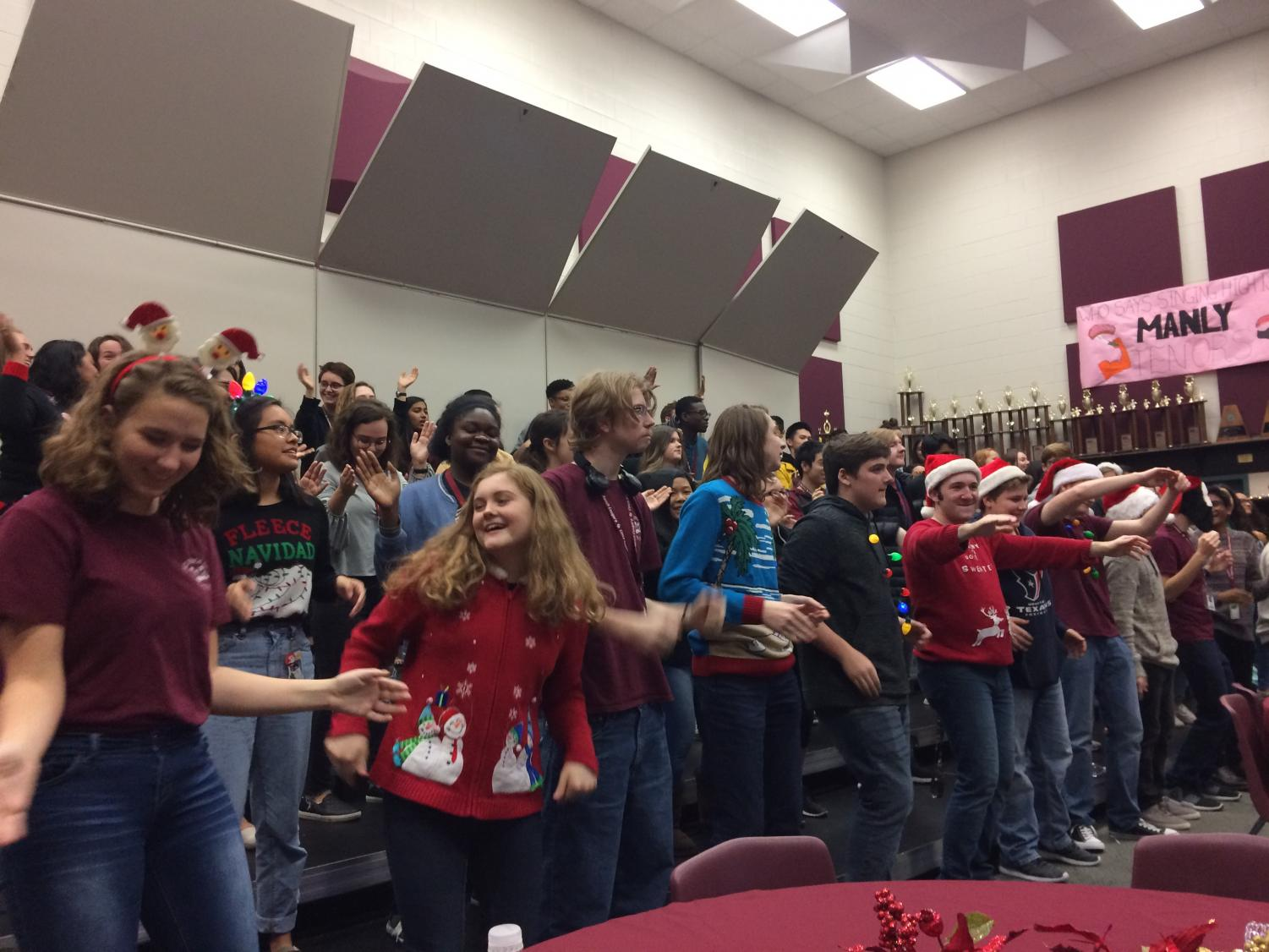 Choir students shared sounds of the season Wednesday throughout the school day as they treated faculty to the inaugural