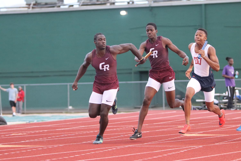 David+Gbenda+recieves+the+baton+for+the+relay+race.