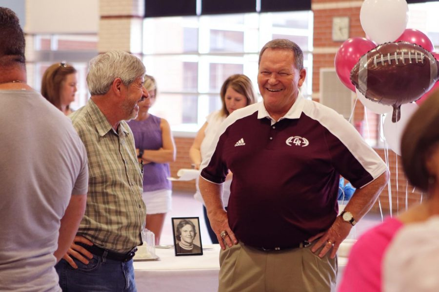 Coach+Don+Clayton+enjoys+his+retirement+celebration+in+the+main+commons+May+22.+Clayton+is+stepping+down+after+20+seasons+at+the+Cougar+football+helm.