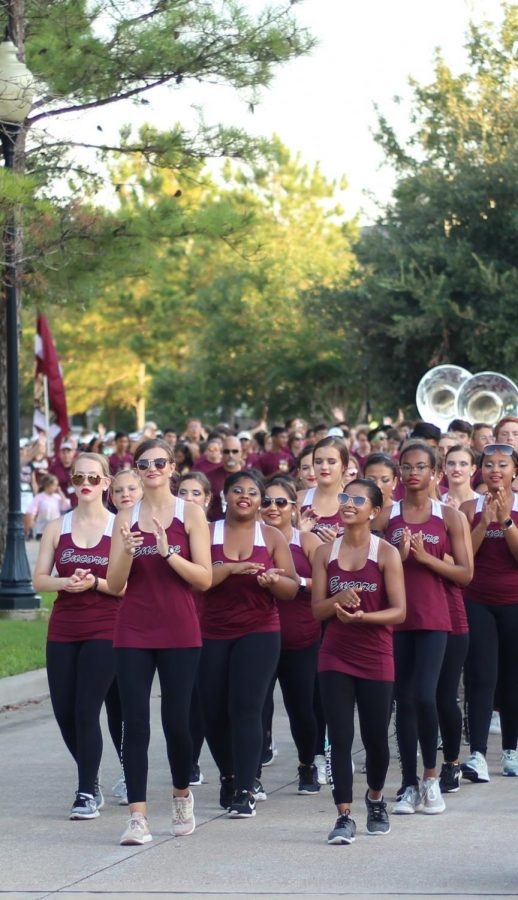 The Encore Dance Company leads the 2019 Homecoming Parade with Cougar spirit.
