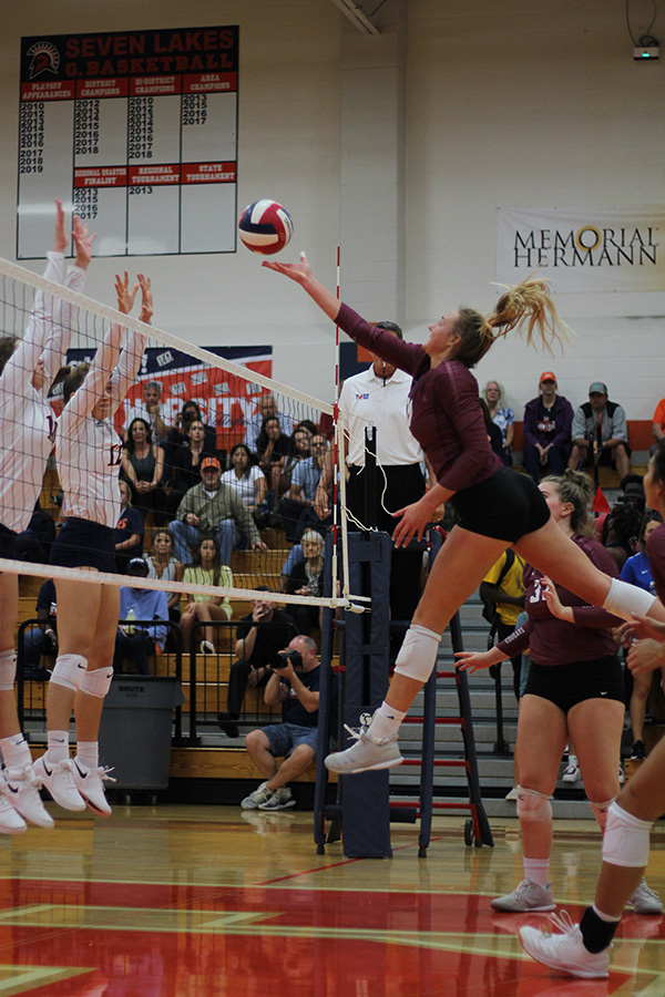 Senior Madalyn O'Brien makes an offensive move at the net against Seven Lakes in the first meeting of the two schools Sept. 17. Varsity begins the second half of district play with a 7-0 mark on a top 25 state ranking.