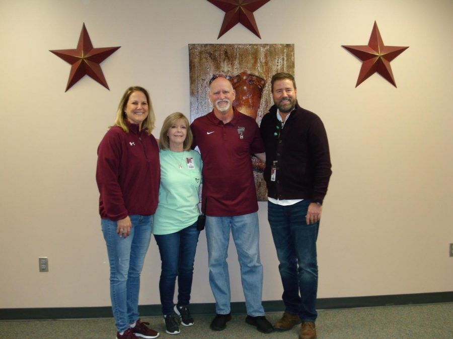 Coach Bruce Hayes receives recognition as CRHS Teacher of the Year in early February. Hayes was honored by 9th grade assistant principal Teri Faigle, Associate Principal Patti Smith, and Principal James Cross after voting selection by the  faculty.
