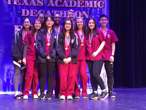 The team poses after winning third place. From left to right: senior Camila Santos, junior Julie Rojas, senior Ria Salway, senior Laurie Dong, senior Ahriel Tyson, junior Hana Chaudhry, senior Christopher Ulrich, senior Danielle Defreitas, senior Theodora Urquhart, and junior Daniel Yang.
