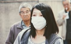 An Asian girl wears a mask in public. 673 cases of discrimination against Asian Americans were reported in March.