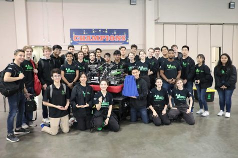 The team poses for a group photo before packing up their robot and leaving the competition venue.
