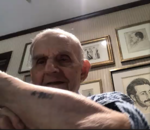 Holocaust survivor Erwin Forley displays his Aushwitz number, A9957, to the School of the New York Times students on June 17 via Zoom.