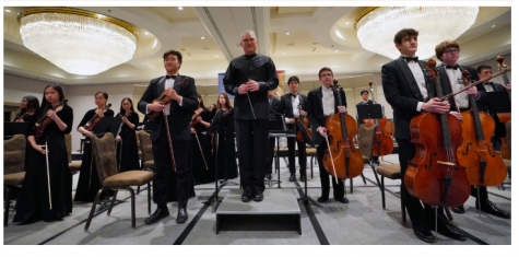 Sinfonia stands for applause after their Grand Champion Concert during the American String Teachers Association (ASTA) National Orchestra Festival.