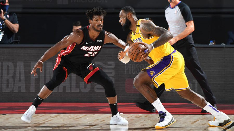 Lebron James (right) tries to dribble past Jimmy Butler (left).  Credit: NBAE via Getty Images
