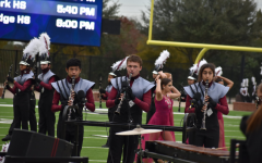 Senior Joseph Kohlmaier (middle) competes in a December marching band competition.